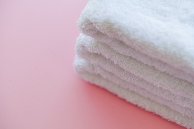 Beautiful spa composition white towels on pink table