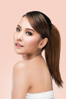 Beautiful Spa model Girl with Perfect Fresh Clean Skin,on pink with clipping path