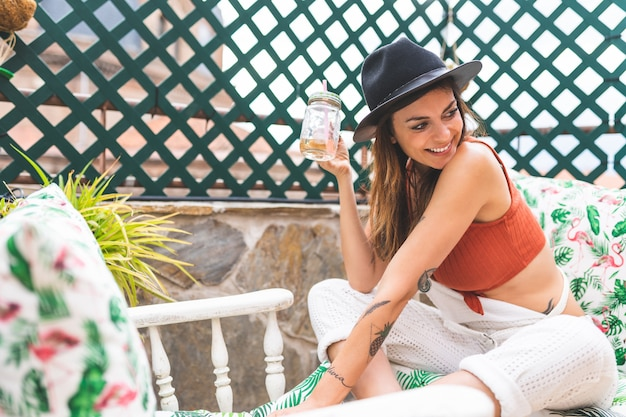 Beautiful spanish woman relaxing in a terrace at home.