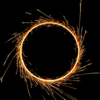 Beautiful sparkler in a circle on a black