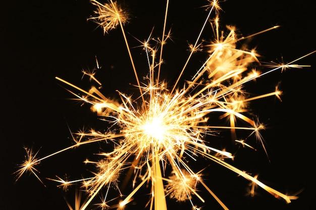 Beautiful sparkler on dark background, close up