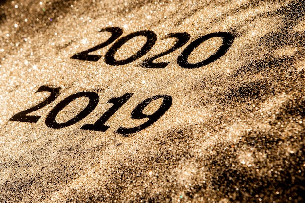 Beautiful sparkling golden numbers of 2019 to 2020 on black background
