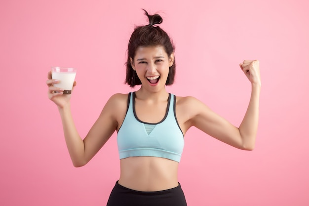 Beautiful sport woman drinking milk
