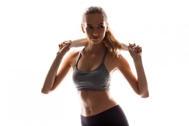 Beautiful sportive woman holding towel, posing