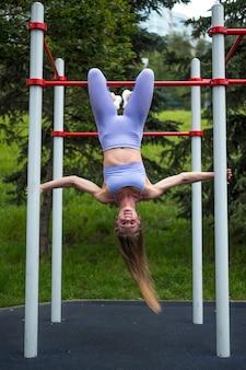 Beautiful sporty woman doing workout long shot