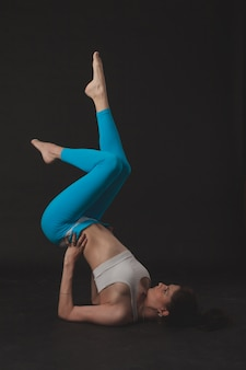 Beautiful sporty yogi girl practices yoga asana