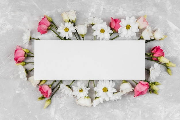 Beautiful spring flowers composition with empty frame
