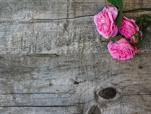 Beautiful, spring flowers lying on shabby boards