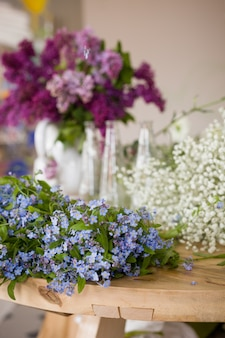 Beautiful spring and summer forget me not flowers lilacs on the table ready for a bouquet