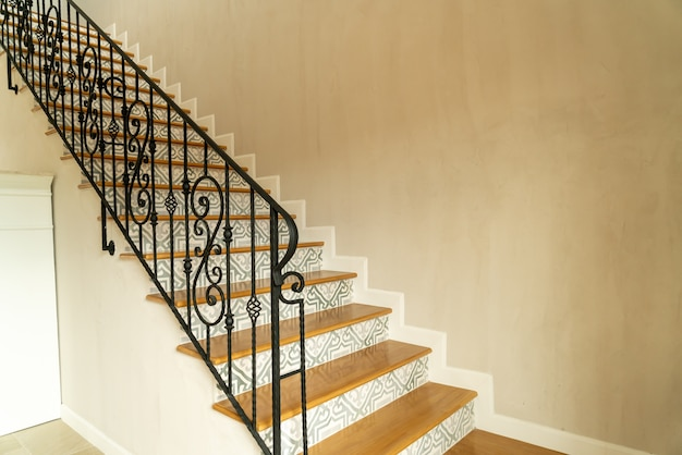 Beautiful stair step with black handrail
