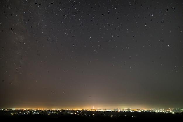 Beautiful starry dark night sky over modern city