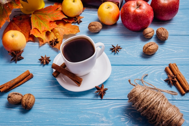 Beautiful still life with coffee in a white cup on a white wooden table