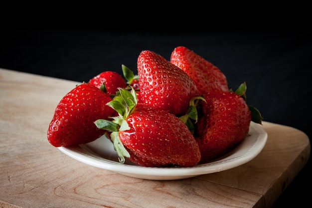 Beautiful strawberries on the wooden table