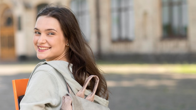 Beautiful student happy to be back at university