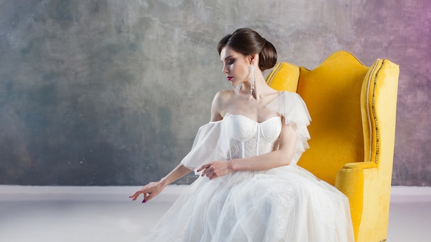Beautiful and stylish bride in wedding dress
