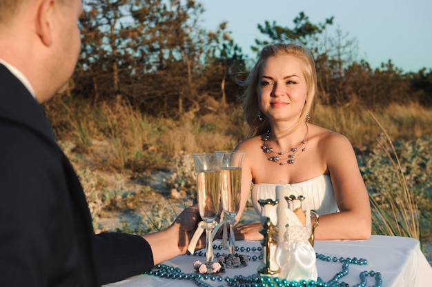Beautiful stylish cheerful young couple in the seaside wedding d