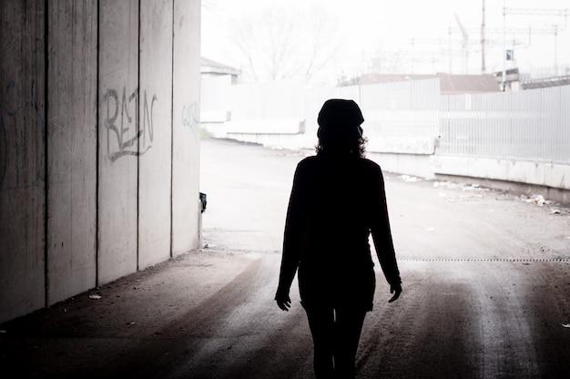 Beautiful stylish woman in a dark tunnel