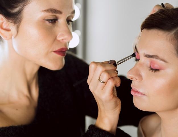 Beautiful stylist working on model