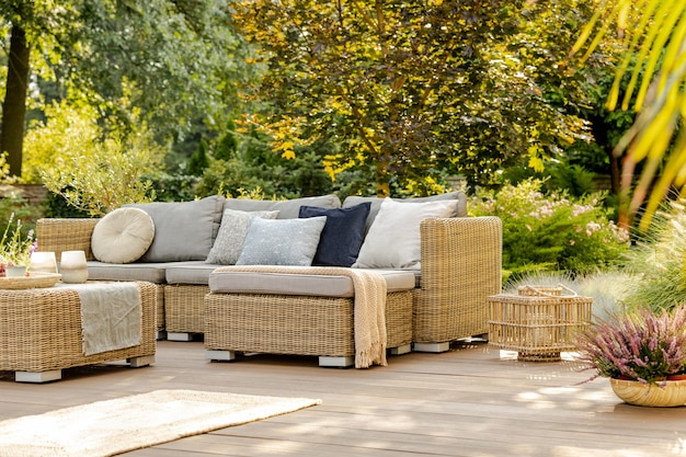 Beautiful summer day in elegant home garden with trendy furniture