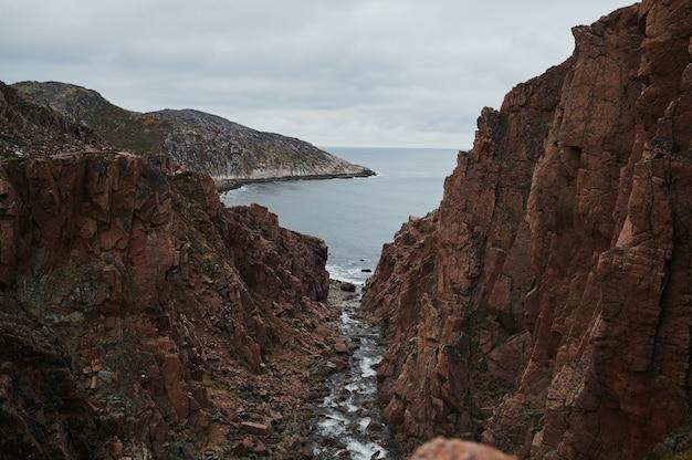 Beautiful summer day landscape abandoned artnature coastal defense north teriberka, barents sea view.