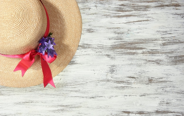 Beautiful summer hat on wooden table