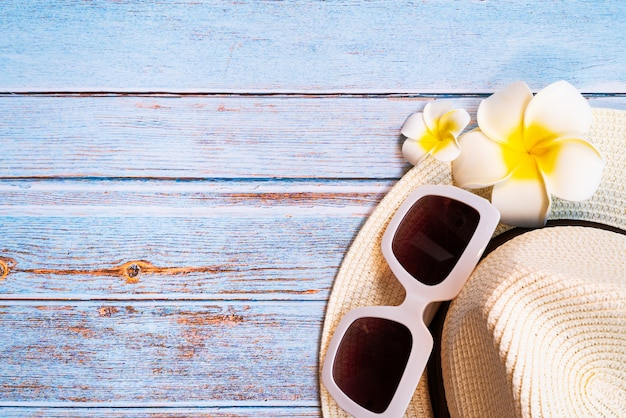 Beautiful summer holiday, beach accessories, sunglasses, hat and flower