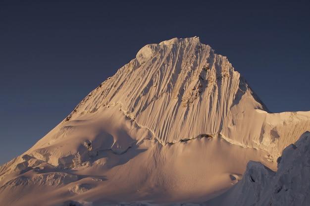 Beautiful summit alpamayo on the sunset