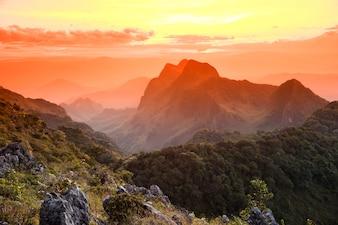 Beautiful sun set and orange sky over mountain