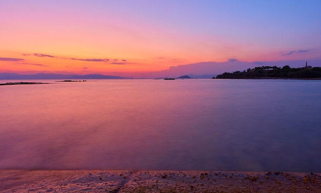 Beautiful sundown over saronic gulf of the aegean sea in aegina island, greece - sunset landscape - seascape. long exposition, the water is totally blurred by motion