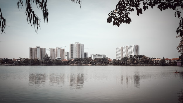 A beautiful sunny day at the lake with buildings and the city background