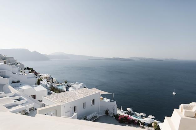 Beautiful sunny island santorini greece there are white houses on the island