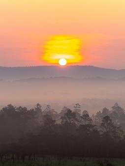 Beautiful sunrise landscape mountain thailand , with colorful vivid sunset nature outdoors  background - landscape during sunset