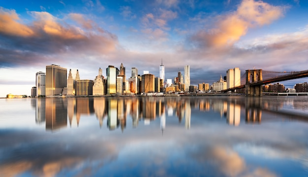 Beautiful sunrise over manhattan with manhattan and brooklyn bridge