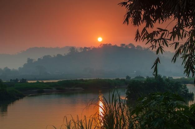 Beautiful sunrise on mekong river, border of thailand and laos, nongkhai province, thailand.