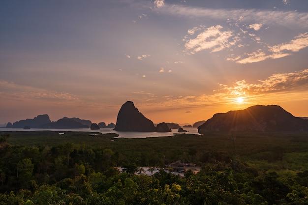 Beautiful sunrise over the mountain at samet nang she, thailand