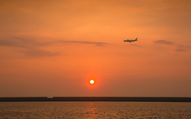 Beautiful sunset and airplane at jeju do island, south korea.