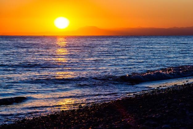 Beautiful sunset on the beach of mediterranean sea in turkey