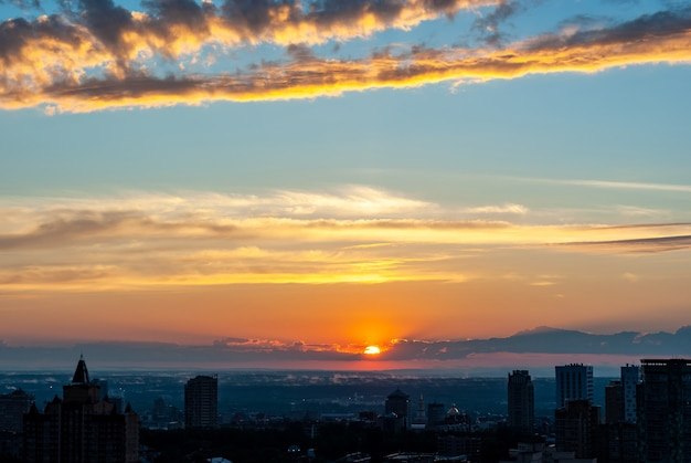Beautiful sunset over the city in summer 2021