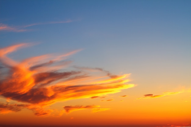 Beautiful sunset clouds in the sky over the sea, bright colors of sunset.