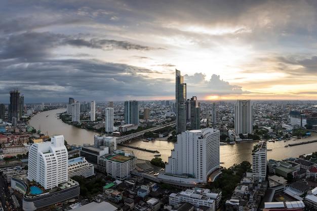 Beautiful sunset curve chao phraya river of bangkok city at night