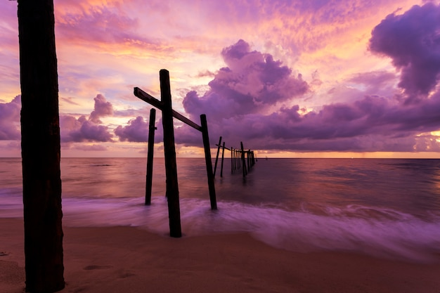 Beautiful sunset dramatic sky over sea with old wooden bridge at khao pilai in phang- nga thailand