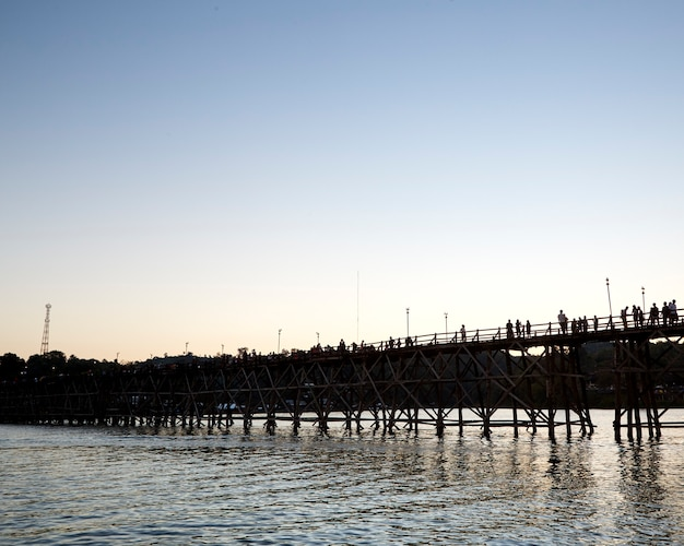 Beautiful sunset scene at old an long wooden bridge asian wooden bridge