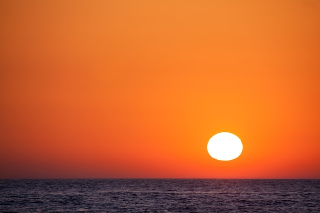 Beautiful sunset over the sea with an orange sky.