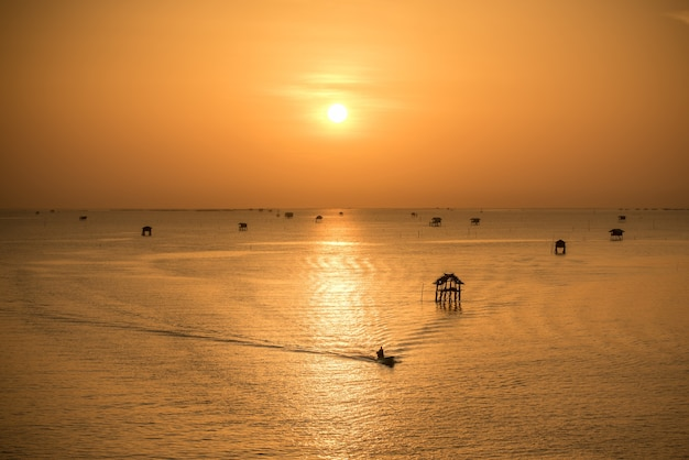 Beautiful sunset on sea with solar path on waves in orange colors