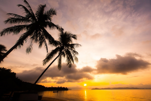 Beautiful sunset sky over tropical beach and sea