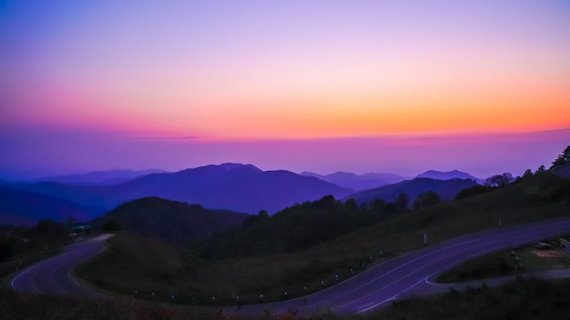 Beautiful sunset sky with mountain and road