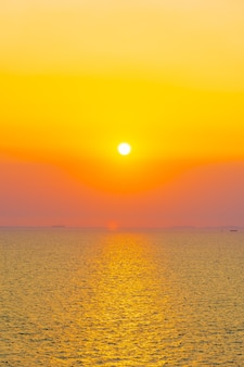 Beautiful sunset or sunrise around sea ocean bay with cloud on sky