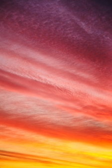 Beautiful sunset or sunrise background. multicolored red orange sky with clouds