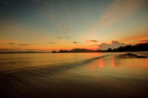 Beautiful sunset over tropical beach and sea in thailand