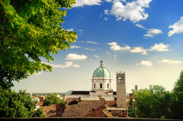 Beautiful sunset view of the duomo cupola over the town brescia in lombardy, italy
